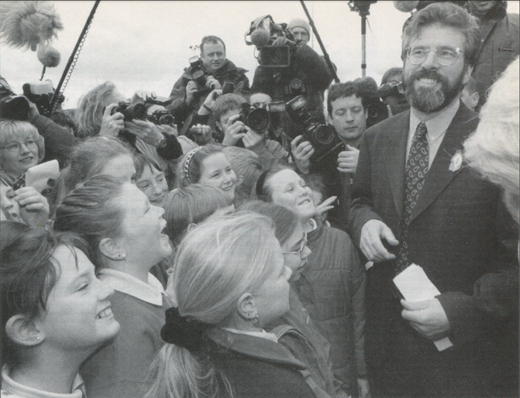 Sinn Féin president Gerry Adams welcomes schoolchildren from Co. Down to Stormont's Castle Buildings on the final day of the multi-party peace talks.