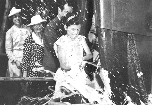 <em>Nancy Moran, daughter of Edmond J. Moran, christens the Liberty Ship </em>Michael Moran<em>, named in honor of her great-grandfather in 1944.</em>