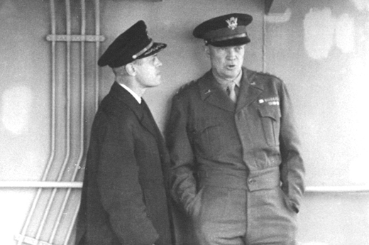 <em>Captain Edmond J. Moran chats with General Eisenhower. Later promoted to Rear Admiral, Moran organized the towing of artificial harbors to the beaches at Normandy, making D-Day landings possible. For his service he was awarded the Legion of Merit, the Croix de Guerre, and the Order of the British Empire.</em>