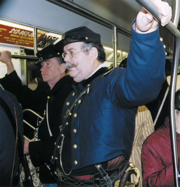 <em>Irish Brigade reenactors take the Lexington Avenue subway from the 69th Regiment Armory on 26th Street to the midtown area where the St. Patrick's Day Parade begins. Rush-hour straphangers seem unfazed by their presence.</em>