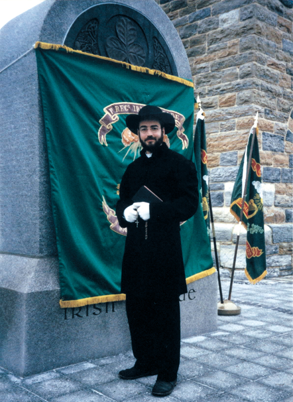 <em>Robert Carter reenacts the roll of chaplain at the 1997 dedication of the monument to the Irish Brigade at Antietam. The uniform, down to the hat, which he had custom made, is based on his research of original photographs.</em>