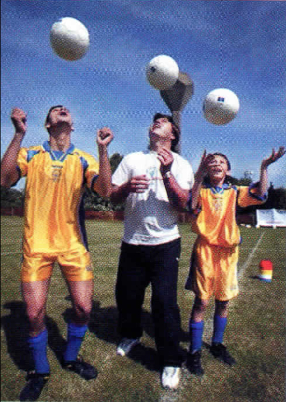 <em>Special Olympic athletes from Cyprus, Emilios Loannou (left) and Petrov Kleovoulos (right), receive soccer tips from coach Roman Koseckiv.</em>