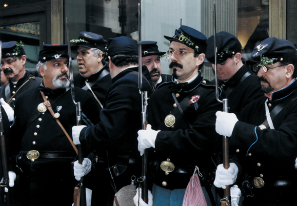 <em>The Irish Brigade reenactors lining up outside Grand Central Station, put on their gloves and get ready to join The St. Patrick's Day Parade.</em>