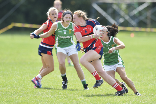 <em>A Chicago St. Brigid's player flying by her Charlotte James Connolly's opponent.</em>