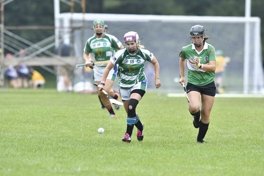 <em>Captain Heather Warren of Coastal Virginia Camogie focuses on winning the ball before a Seattle Gaels camog does.</em>