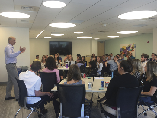 <em>Mike addressing a group of Boston Scientific summer interns.</em>
