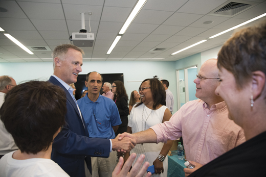 <em>Mike greets a patient with a Boston Scientific stent and his wife, along with other members of the team.</em>