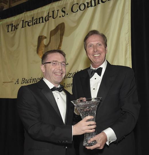 <em>Consul General Ciarán Madden presents Dr. John Lahey with the Lifetime Achievement Award.</em>