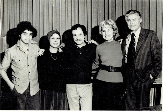 A younger Arturo with his parents, Lupe and Chico; family friend and music writer Graham; and a friend.
