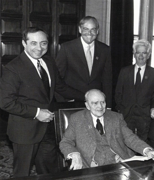 <em>Albany introduces Dearie's bill, the MacBride Principles, signed into law later that year by Gov. Mario Cuomo (first in the nation). Clockwise from left: Gov. Cuomo, John Dearie, Paul O'Dwyer, and Sean MacBride. 1986.</em>