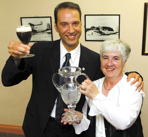 <em>Festival Director, Margaret O'Shaughnessy, bestows Siletti with the Irish Coffee Champion honor.</em>