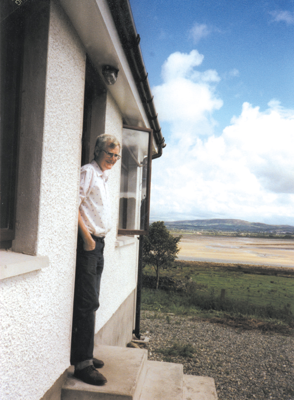 <em>Paddy on the steps of his home overlooking the Isle of Doagh.</em>