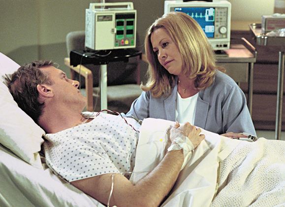 <em>Playing the dedicated wife, Hicks with her onscreen husband.</em>