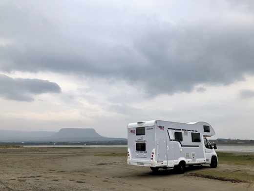 "The big camper van, nicknamed ""Maury,"" at rest on a quiet bay near Sligo."