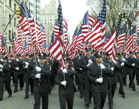 St. Patricks Day Parade 2002 Rookie firefighters carry American flags for each of the 343 firemen who died on September 11 2001.